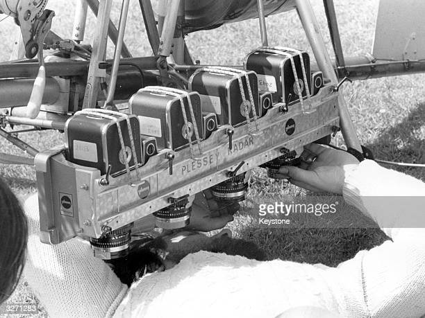 An infrared camera is adjusted for mounting on an autogyro piloted by Wing Commander Kenneth Wallis to take photographs up to 2000 feet above the...