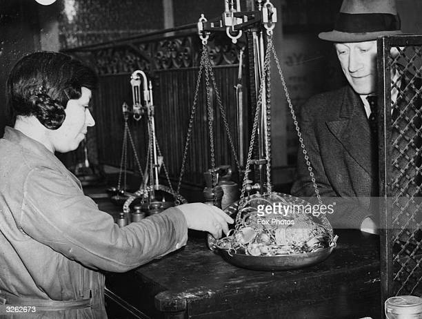 Weighing jewellery for the Jewish refugee fund at Hatton Garden.