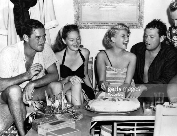 23rd November 1946 Film Stars Errol Flynn with Mrs Nora Flynn Rita Hayworth and her husband Orson Welles relax together on holiday in Acapulco Mexico