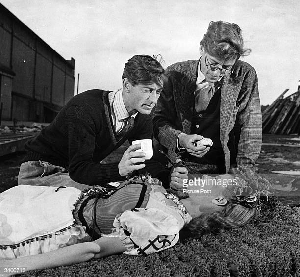 Film-making twins Roy Boulting and John Boulting give directions to a young Honor Blackman on the set of the Two Cities/Rank production 'Fame is the...