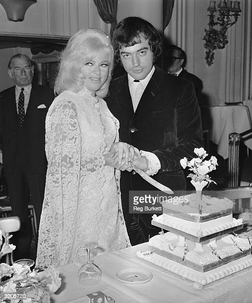 Alan Lake and Diana Dors cutting the cake at their wedding reception in the Astor Club