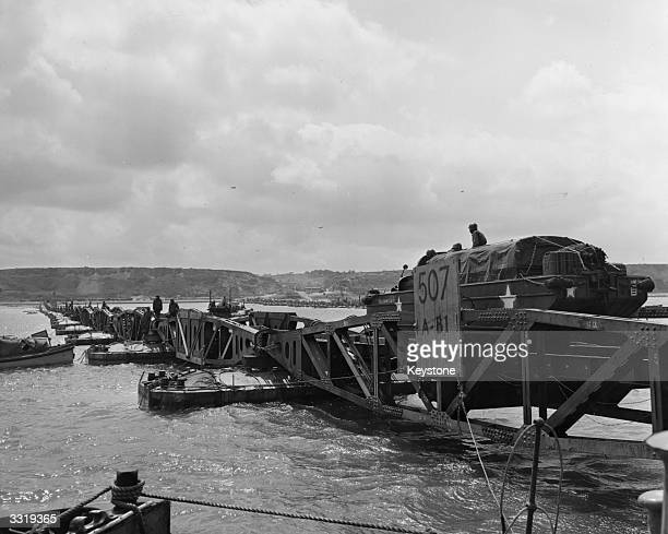 'Mulberry', the secret floating harbour being put to good use on Omaha beach in Normandy as a large truck drives over one of the pontoons. Mulberry...