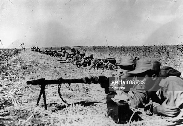 Israeli infantry man their machine guns and rifles before attacking the Egyptian Army and making a breakthrough on the Negev