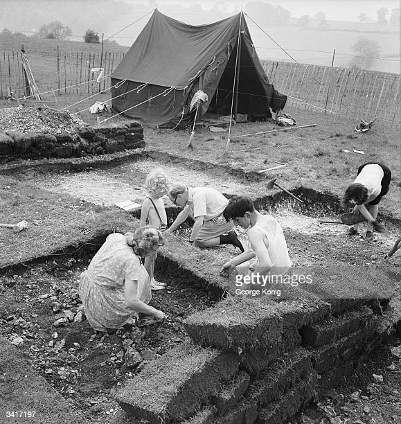 Meticulous care is taken as every inch of ground is plotted for inspection during archaeological excavations into ancient Saxon burial sites along...