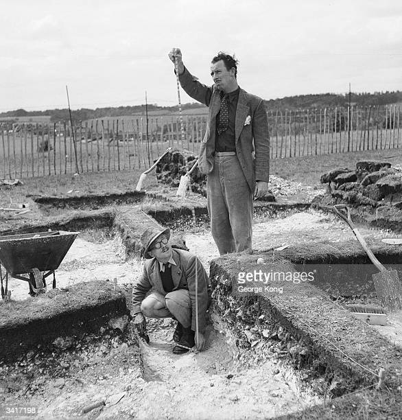 Meticulous care is taken as every inch of ground is minutely inspected with pen knives during archaeological excavations into ancient Saxon burial...