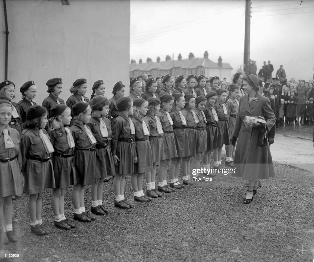 Princess Elizabeth inspects the Princetown Company of Guides and Brownies at Princetown Town Hall, at the end of her tour of Devon and Cornwall.