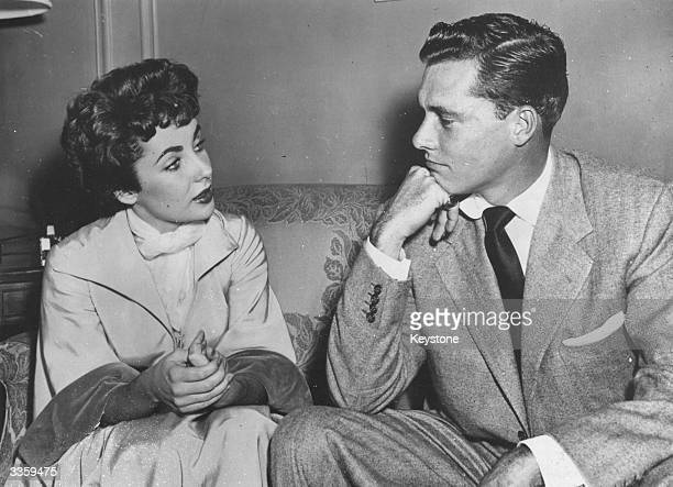 American film actress Elizabeth Taylor with Nick Hilton meet to discuss a property settlement after their 205 day marriage Hilton the hotel chain...