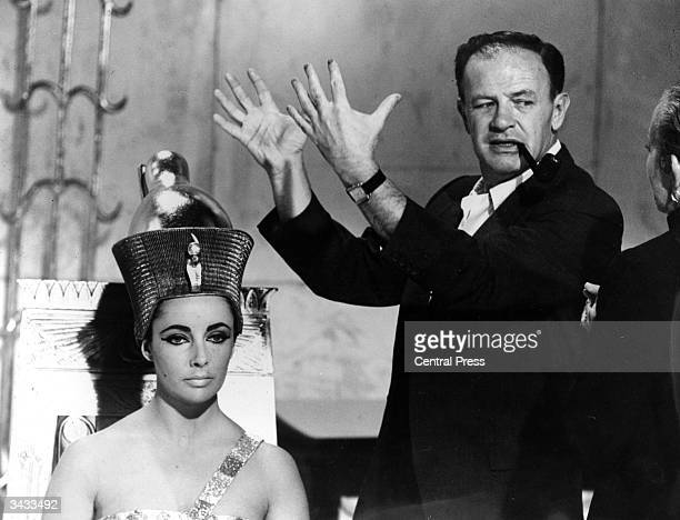 American director Joseph L Mankiewicz discusses Elizabeth Taylor's Egyptianstyle headdress with costume designer Irene Sharaff on the set of the 20th...