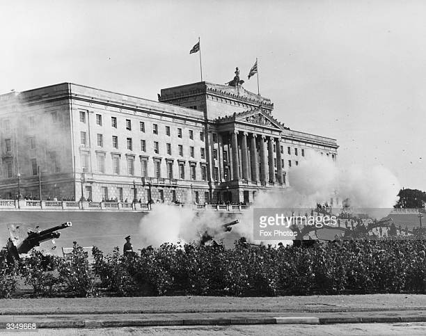 A 21 gun salute sounds the opening of the Northern Ireland parliament at Stormont Castle in Belfast