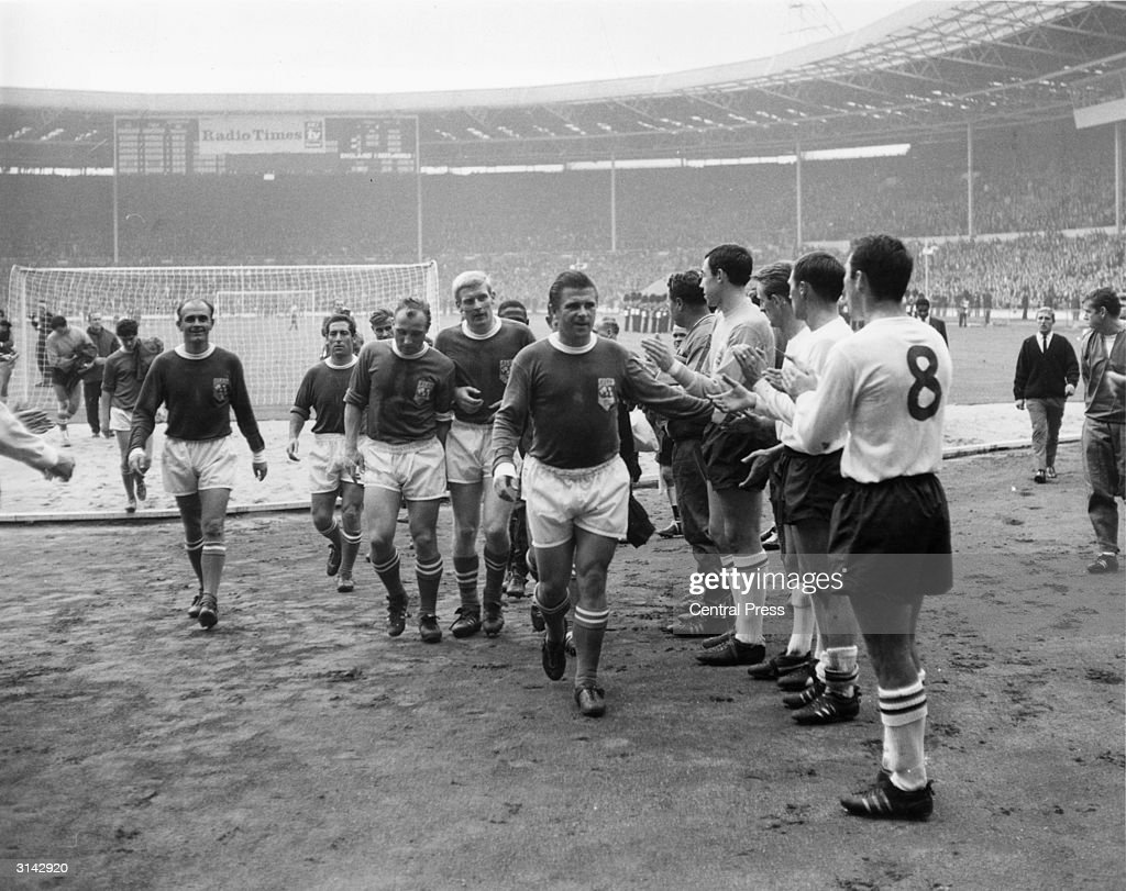 Members of the England team applauding Rest of the World players as they come off the field after the Football Association Centenary Match at Wembley. England won 2-1. Players are: (left to right) Alfred Di Stefano (Spain), Francisco Gento (Spain), Uwe Seeler (West Germany), K Schnellincer (West Germany), Ferenc Puskas (Spain), Gordon Banks (Leicester City), George Eastham (Arsenal), Richard Wilson (Huddersfield Town) and Jimmy Greaves (Tottenham Hotspur).