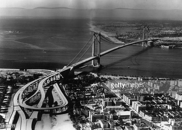An aerial view of the nearly completed Verrazano Narrows Bridge from the Brooklyn side looking towards Staten Island The three mile long structure...