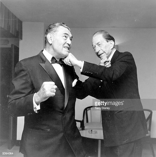 American oil executive multimillionaire and art collector J Paul Getty having a pretend boxing bout with the former heavyweight champion Jack Dempsey...