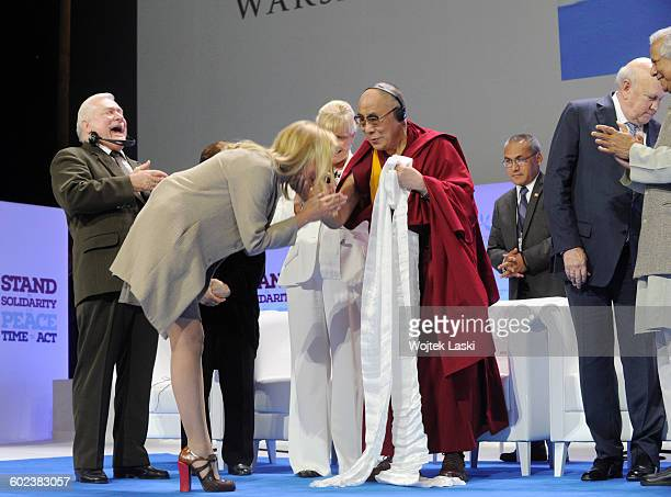 Former Polish President Lech Walesa American actress Sharon Stone and the 14th Dalai Lama at the 13th Annual Summit of Nobel Peace Prize Laureates...