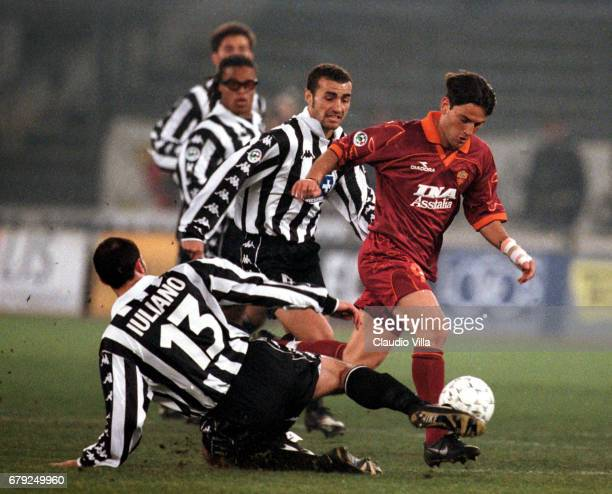 A 23rd round JUVENTUS Vs ROMA 21 VINCENZO MONTELLA of AS Roma MARK IULIANO AND PAOLO MONTERO compete for the ball