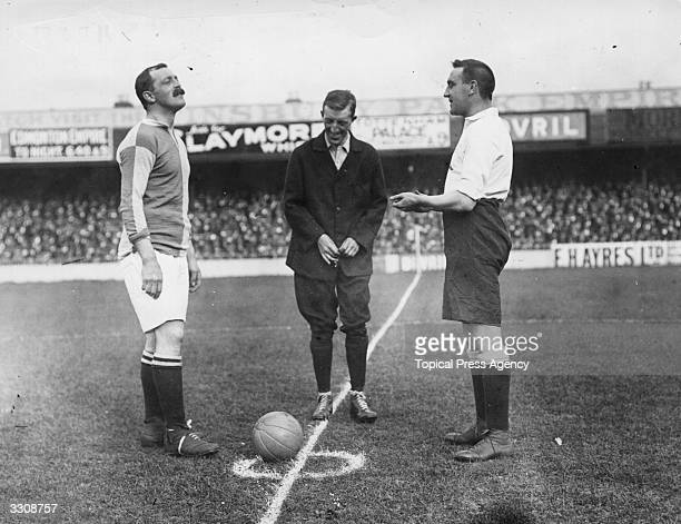 Stede and Crompton toss up before the kick off of a match between Tottenham Hotspur and Blackburn Rovers at White Hart Lane