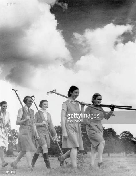 Young members of the Women's Land Army set out for a day's work on a farm in Cheshire
