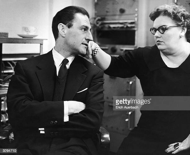 Italianborn American composer Gian Carlo Menotti with soprano Eileen Farrell during a recording of an aria from 'The Consul'