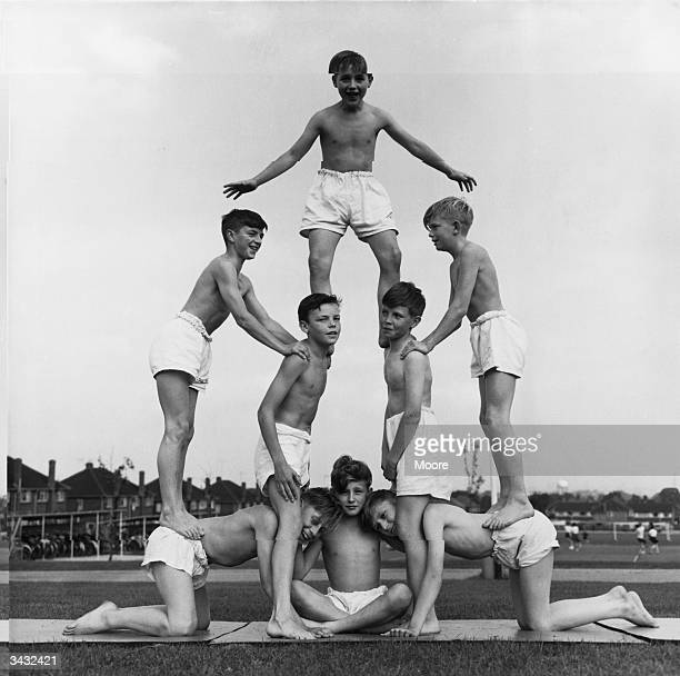 Pupils at Kingsbury School balancing on each other to form a pyramid