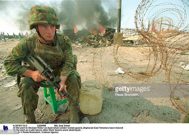 N 357877 013 23Sep99 Dili East Timor At The Port In DiliEast Timor An Australian Solider Stands Guard Displaced East Timorses Have Moved To The Port...