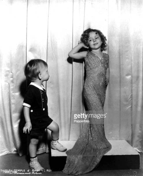 23th October 1934 Four year old American Actress Shirley Temple smiles at an even younger admirer in Hollywood USA