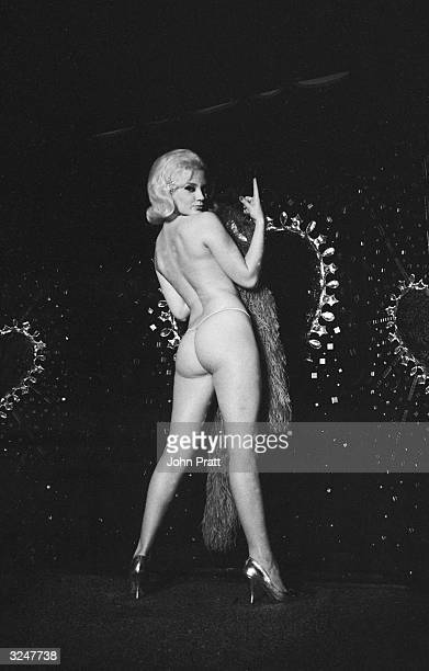 23yearold stripper Poupee La Rose nears the end of her act at the Bacchi Wapen in Stockholm