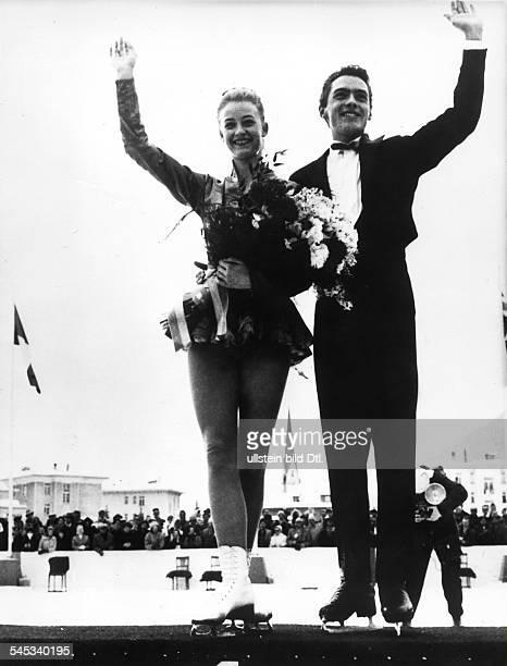 *Eiskunstläuferin Sportlerin Dmit Partner HansJürgen Bäumler bei derSiegerehrung der Europameisterschaftenim Paarlauf in Davos