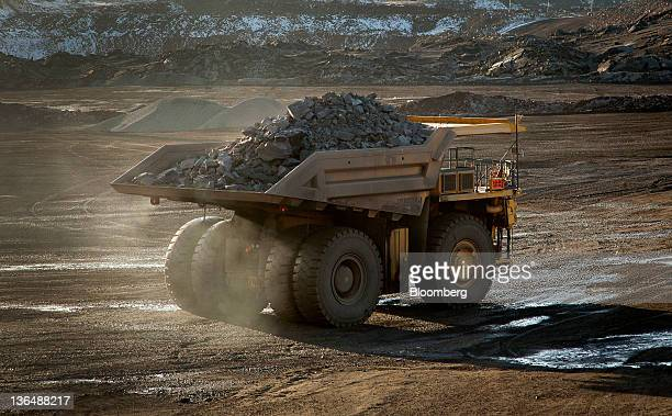 A 240ton capacity production truck drives out of an open pit mine with a load of taconite heading to the Hibbing Taconite Co pellet manufacturing...