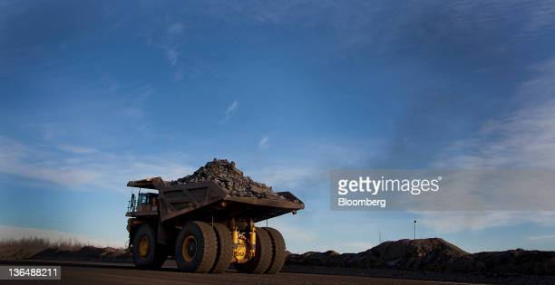 A 240ton capacity production truck transports a load of taconite from an open pit mine to the Hibbing Taconite Co pellet manufacturing plant operated...
