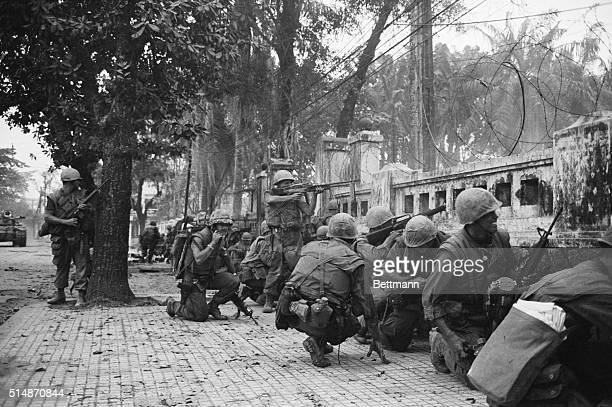 2/4/1968Hue South Viet Nam US Marines keeping lowbecause of intense sniper fire battle communist units which seized two thirds of the ancient...