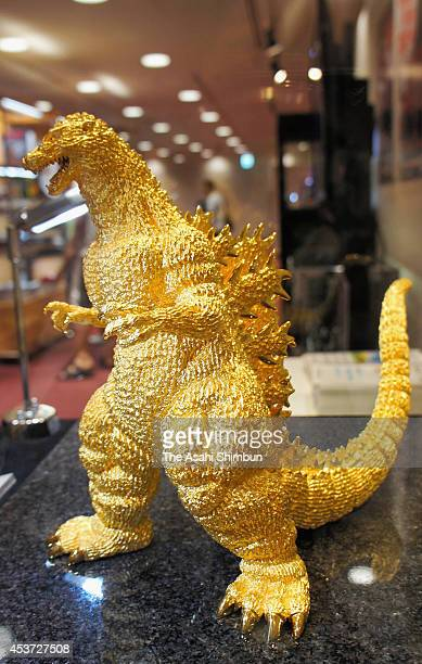 A 24centimetertall pure gold statue of Godzilla is displayed at the Godzilla exhibition at Kintetsu department store Art building on August 16 2014...