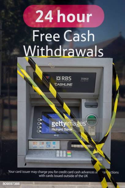 A 24hr ATM cash dispenser operated by the RBS banking group and the Tesco supermarket is taped up and out of order in Camberwell on 5th July 2017 in...
