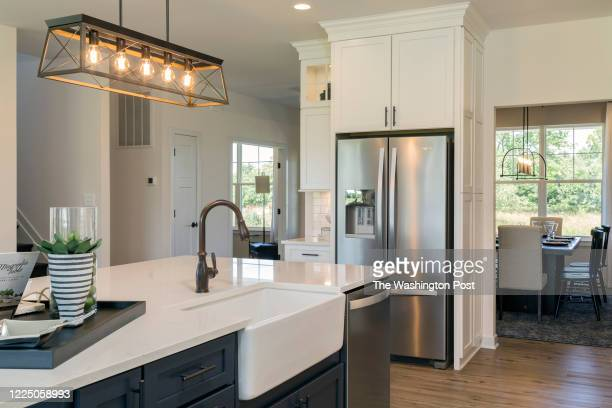 Kitchen Island with door to Dining Room in the Rosslyn Model Home at Thorburn Estates on June 24, 2020 in Fredericksburg Virginia.
