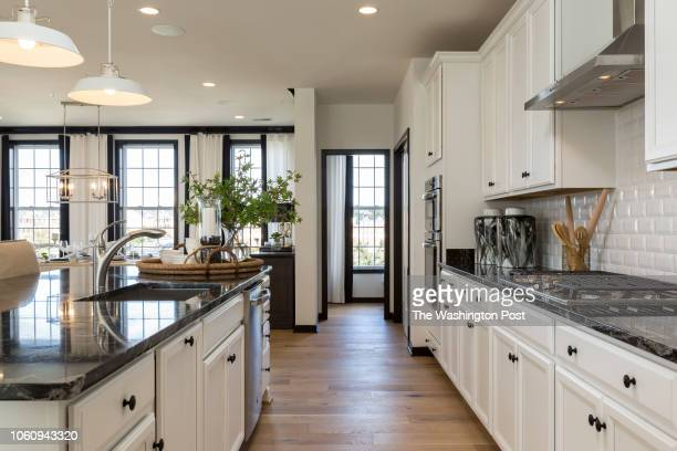 Kitchen with Powder Room at front of the home in the Delanie model home at Loudon Valley The Carlisle on October 24 2018 in Ashburn Virginia