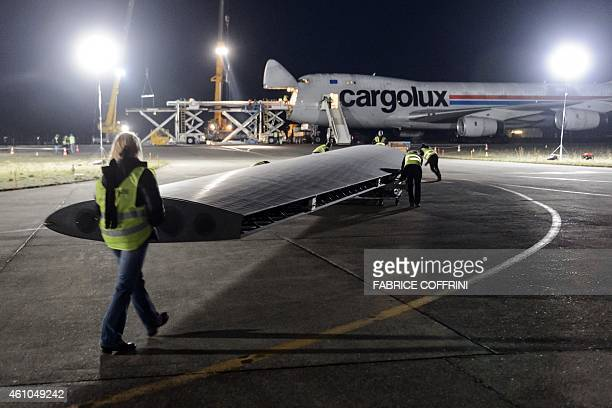 A 24m long wing element of sunpowered plane Solar Impulse 2 is loaded to Cargolux Boeing 747 cargo aircraft on January 5 2015 at Payerne airport A...
