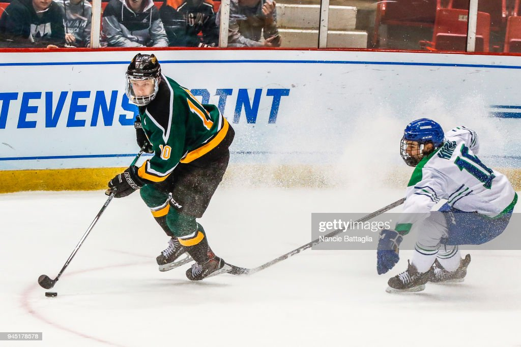 PLACID, NY - MARCH 24--Peter Bates, of St. Norbert skates ...