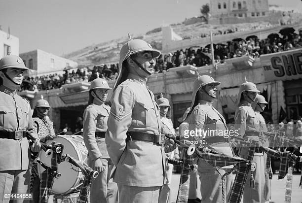 24th anniversary of Arab revolt under King Hussein & Lawrence 1940. Band of the Arab Legion lining the streets.