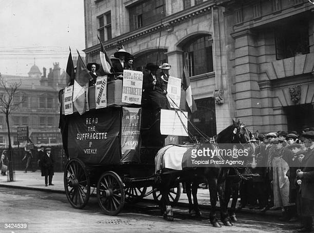 Suffragettes on a horsedrawn bus decorated in the Suffragette colours of white violet and green tour around London promoting their paper 'The...