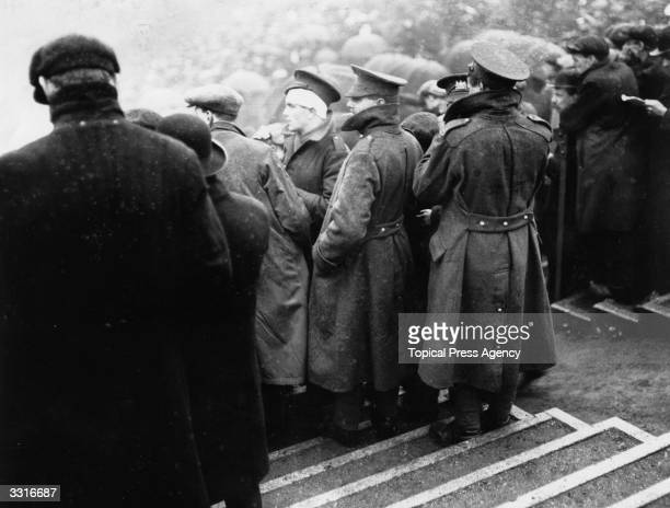 Wounded soldiers watch the FA Cup Final between Sheffield United and Chelsea at Old Trafford Manchester