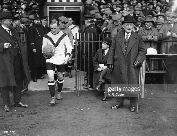 Newcastle United Football Club captain Frank Hudspeth leads his team on to the field for the third round FA Cup game against Watford at Watford