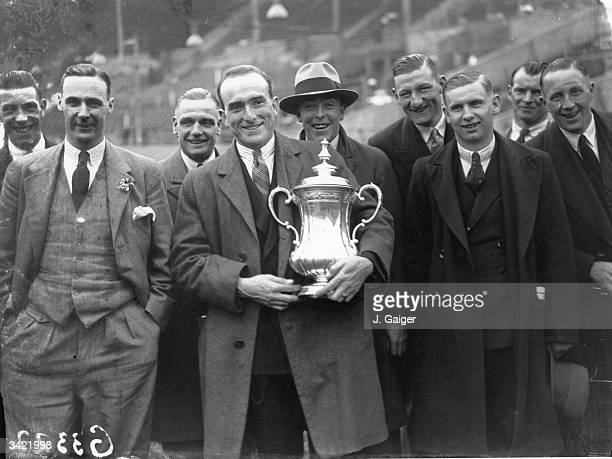 The triumphant players of Arsenal FC with the FA Cup trophy after 20 victory over Huddersfield Town at Wembley Stadium Tom Parker holds the trophy