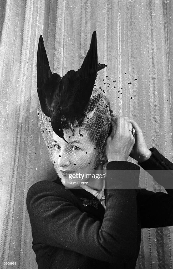 A model wearing an Easter bonnet, decorated with a bird, designed by milliner Rose Bertin. Original Publication: Picture Post - 1424 - Crazy Easter Bonnets - pub. 1943
