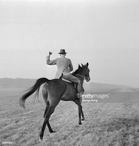 Racehorse trainer Walter Earl on the paddock at Stanley House Stables in Newmarket Heath in training for May's big racing event the Derby One Thousand