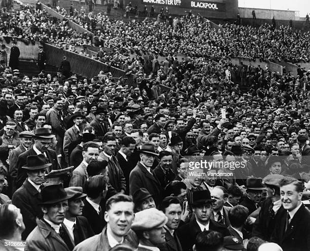 Section of the crowd at Wembley Stadium before the start of the FA Cup Final between Manchester United and Blackpool.