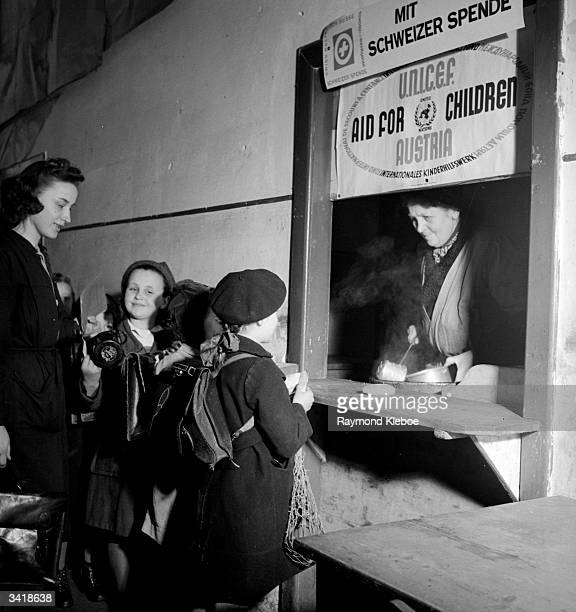 Children at a hatch where UNICEF workers are dispensing aid to people in Vienna Austria Original Publication Picture Post 4538 UNICEF Sets About The...