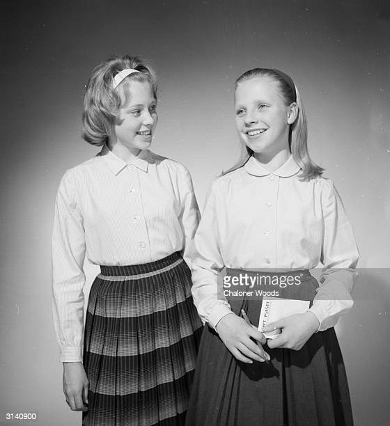 Schoolgirls wearing pleated skirts and long sleeved blouses by Vyella