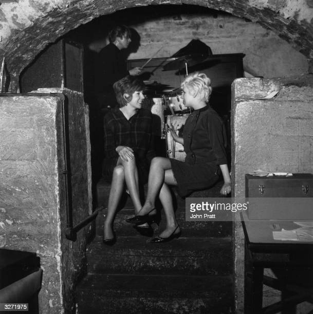 Pop singer Cilla Black talking to a friend at the Liverpool music venue The Cavern where The Beatles had a residency early in their career