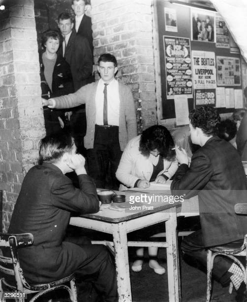 Visitors to Liverpool's famous Cavern Club file down the steep stairs and are let in by a bouncer they are then required to sign in before gaining...