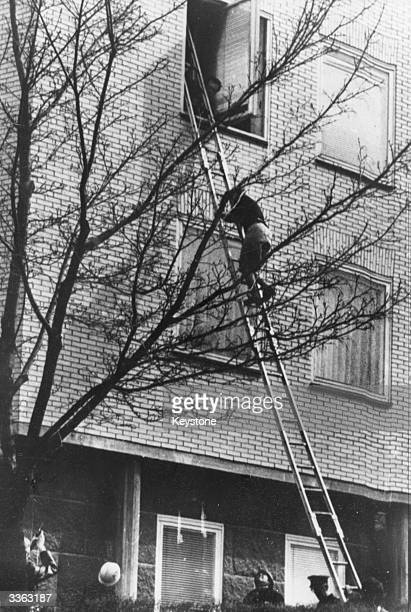 A woman is rescued from the West German embassy in Stockholm after it was stormed by terrorists demanding the release of Red Army Faction prisoners...