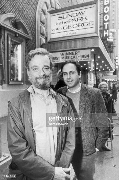 LR American composer Stephen Sondheim and playwright James Lapine pose in front of the marquee of the Booth Theatre on 45th Street New York City They...