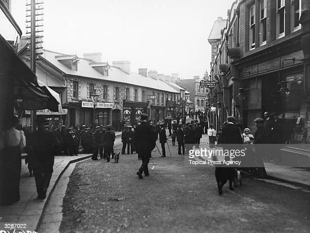 Mobs congregating at dusk during AntiSemitic riots in Bargoed and other Welsh towns due to scarcities caused by the transport strike and the...